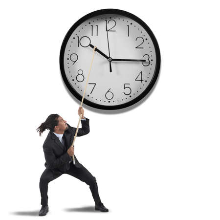 overtime: Business man tries to change the time Stock Photo
