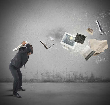destroying: Businessman overloaded and stressed out from work Stock Photo