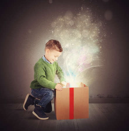 baby open present: Child amazed by the big magic gift
