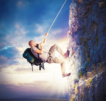 rock climb: Explorer and his passion for climbing mountains Stock Photo