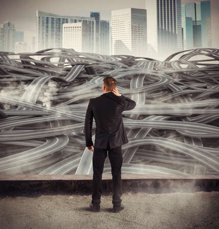Businessman with many choices paths to take