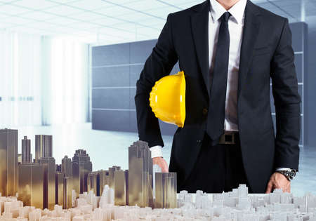 highrise: Architect in office shows the urban project Stock Photo