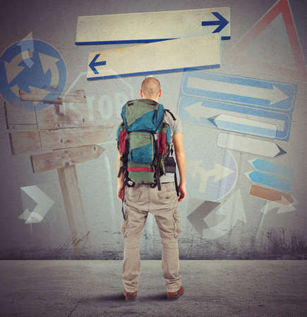 confuse: Lost traveler undecided which way to go
