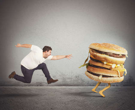 angry person: Insatiable fat man runs for catch sandwich