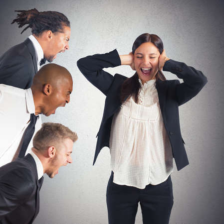 distrust: Businesswoman tired of hearing the leaders screams