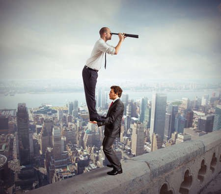 Business people working together to look beyond