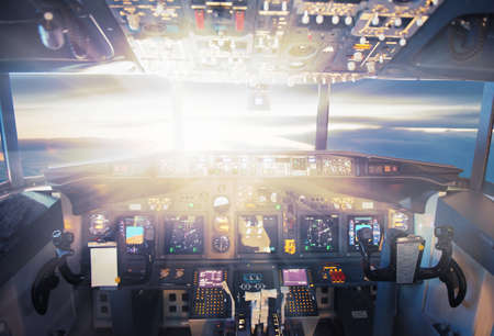 controls: Pilot controls aircraft in the sunset lights