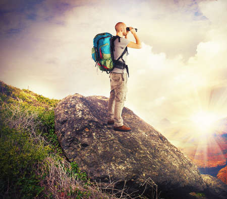 observes: Explorer observes in search of new lands Stock Photo