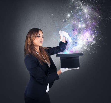 Woman magician makes magic with her hat