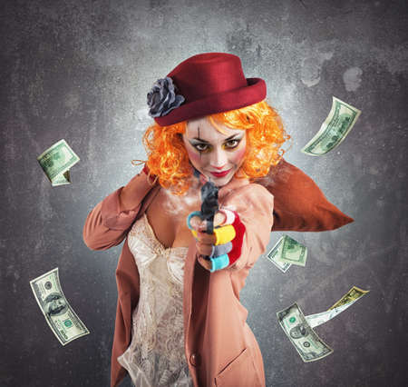 loot: Clever thief clown thief steals money loot Stock Photo