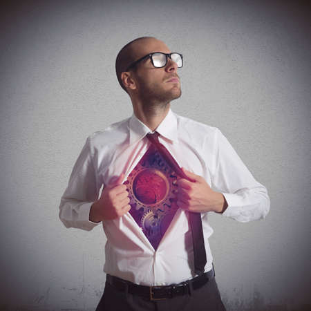 Businessman becomes a super hero of gear Stock Photo