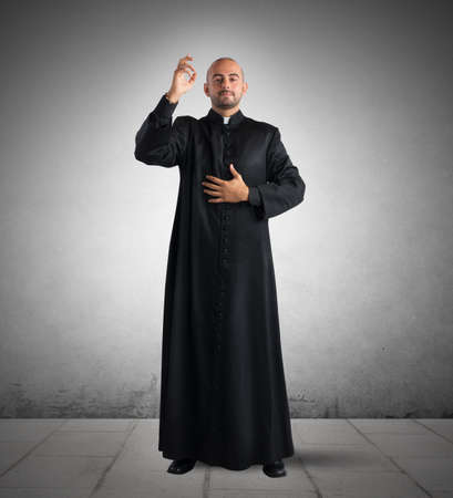clergyman: Priest is a blessing to the faithful Stock Photo