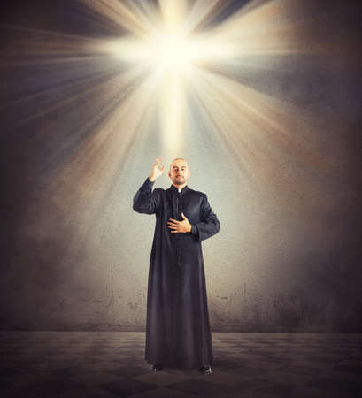 cassock: Priest is a blessing to the faithful Stock Photo