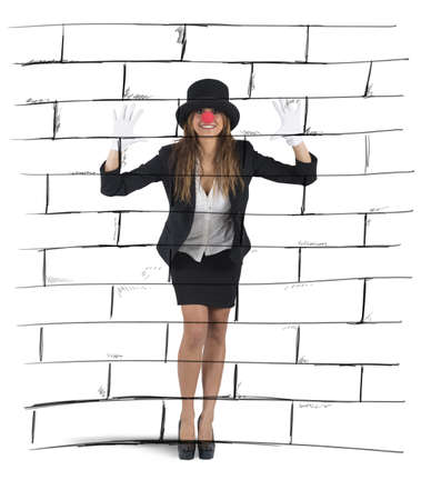 imagining: Businesswoman plays to mime imagining a wall