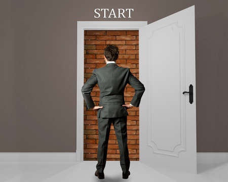 arduous: Businessman at the beginning of opportunity hampered