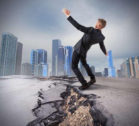 surmount: Businessman trying to overcome a deep break