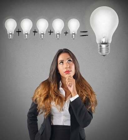 ponder: Businesswoman sum various ideas for a brilliant idea Stock Photo
