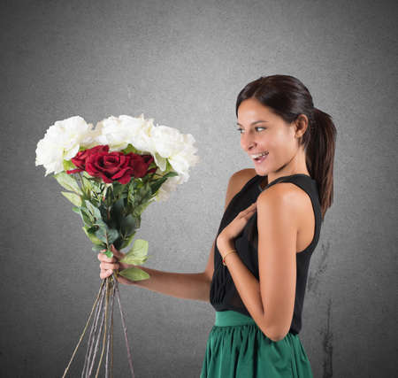 receives: Girl receives a gift of flowers unexpected