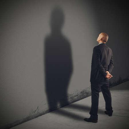 admires: Businessman admires his shadow more than him
