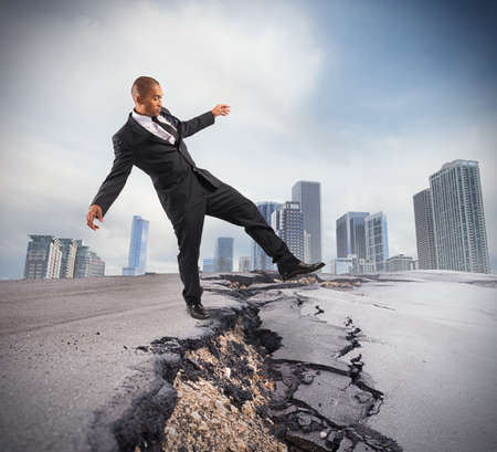 overcome: Businessman trying to overcome a crisis break