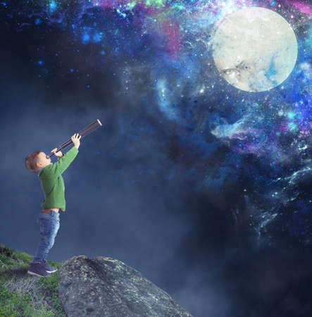 attain: Child fascinated watching the moon with binoculars