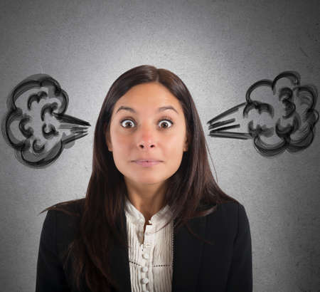 funny people: Businesswoman stressed with the brain in smoke Stock Photo