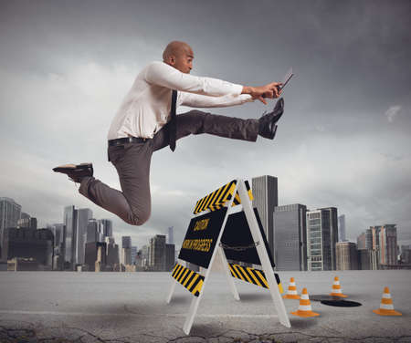overcome: Businessman distracted trying to overcome a hazard Stock Photo