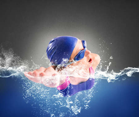 swimming goggles: Girl swims in the pool in freestyle