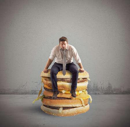 man think: Businessman sitting on a big double sandwich