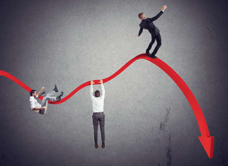 economy: Businessmen falling down toward the economic crisis Stock Photo