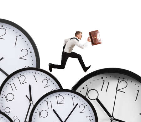 Businessman runs overload of work always late Foto de archivo