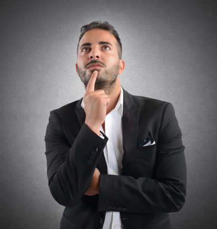 Businessman thinking about what decision to take