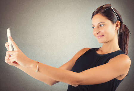 technological and communication: Girl with mobile phone likes to shoot Stock Photo