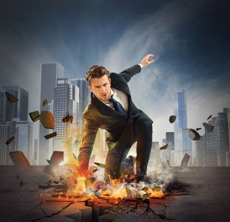 BUSINESSMEN: Businessman determined breaks the asphalt with force Stock Photo