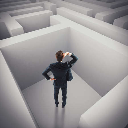 problematic: Businessman in trouble lost in a maze