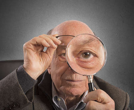 Elder magnifies and tries with magnifying glass