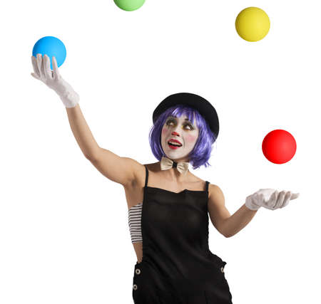 juggler: Concentrated juggler clown playing with colorful ball