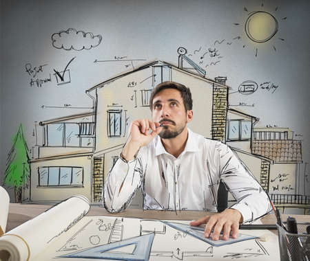 Architect thinks how to design a house Stock Photo
