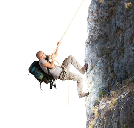 man climbing: Explorer and his passion for climbing mountains Stock Photo