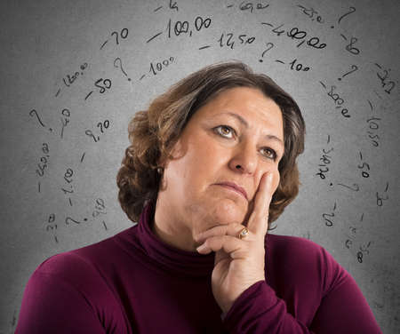 repay: Worried woman thinks like repay its debts Stock Photo