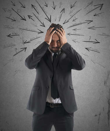 indecision: Worried stressed businessman by indecision and problems