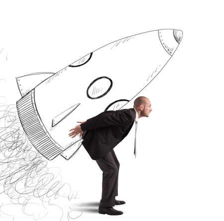 business success: Businessman dreams to achieve success with spaceship Stock Photo
