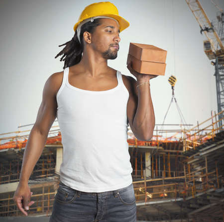 builds: Sexy man mason builds buildings with bricks