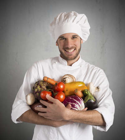 specialized: Chef specialized in vegetarian with fresh vegetables Stock Photo