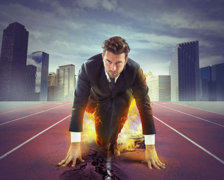 running businessman: Fiery and determined businessman ready to compete Stock Photo