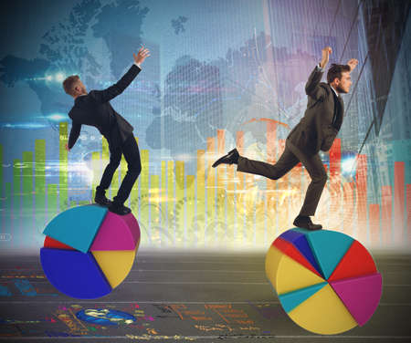 uncertainty: Business people as finance and economy acrobats Stock Photo