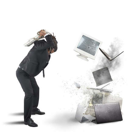 destroying: Businessman stressed out from work breaks computers Stock Photo
