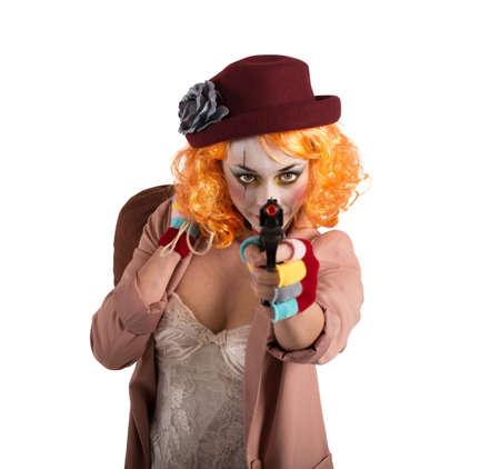trickster: Thief clown aims to hit with gun