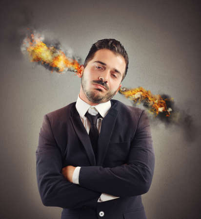 stressed out: Businessman stressed out with ears in smoke