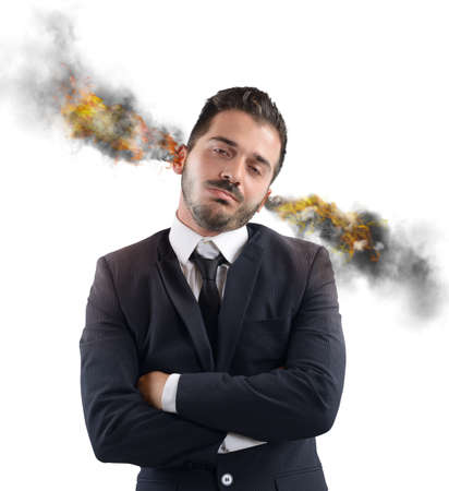 emotional stress: Businessman stressed out with ears in smoke